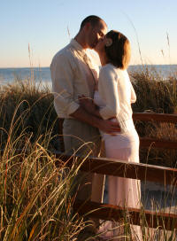 Newly Married Couple kissing at Clearwater Beach